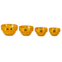 Bee hive measuring bowls against a white background