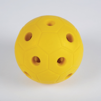 Yellow ball made from hard foam with holes so bells can be heard