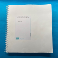 Front cover of IPA code book against a blue background