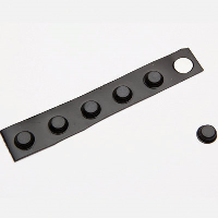 A strip of round black flat head bumpons with one detached