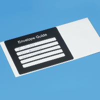 Close-up of the Envelope guide placed on an envelope with an address written