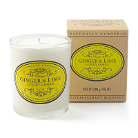 Ginger and lime candle against a white background