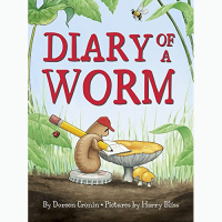 Front cover of Diary of a Worm showing illustrated worm doing his homework on a mushroom table