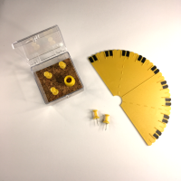 Semi-circular yellow protractor with cork and pins