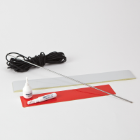 White reflective tape, red reflective tape and elastic cord on a table top