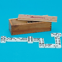 White dominoes with black dots in front of the wooden storage case