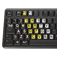 Large print stickers placed on the keys of a standard Qwerty keyboard.