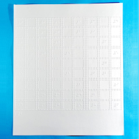 Sudoku puzzle sheets against a blue background