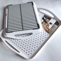 Two trays showing the anti-slip material on both the top and bottom of the tray