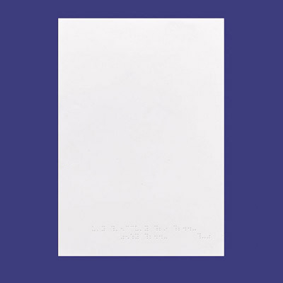 An upright sheet of white braille cartridge paper
