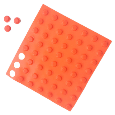 Sheet of orange bumperstops with three detached