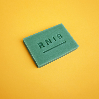 Small green soap in packaging
