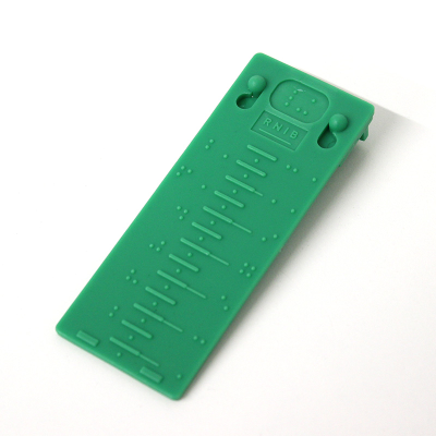 Front view of braille gauge against a white background