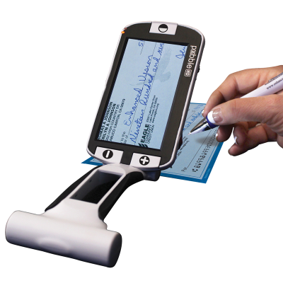 A person reading handwriting on 3 Inch handheld video magnifier