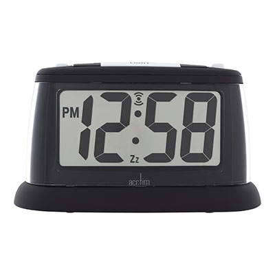 An illuminated easy-to-see LCD alarm clock at night time