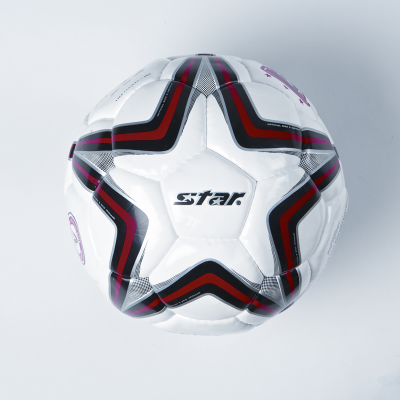 White size four football with the star-shaped red and black printed design visible