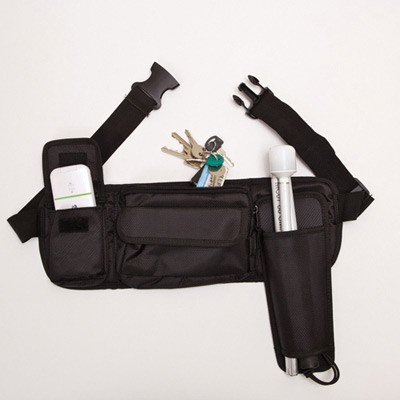 Black belt-pack cane holster with a cane; keys and a mobile phone in pockets