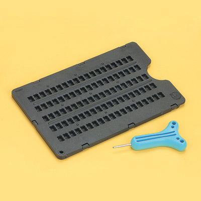 Braille frame against a yellow background