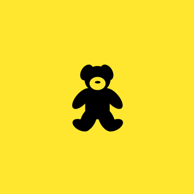 Black teddy bear on a yellow background.