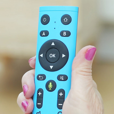 A woman using the GuideConnect TV package