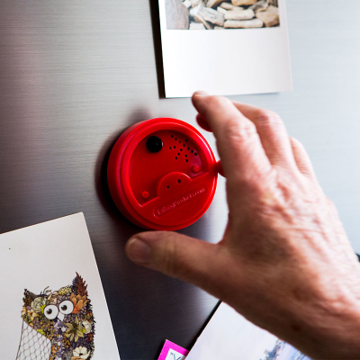 A magnetic voice recorder on a metallic fridge