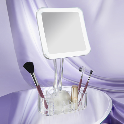 Front view of square mirror with clear plastic tray against a grey backgorund
