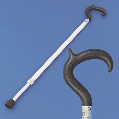 Long white walking stick next to a close up of the black crook shape handle