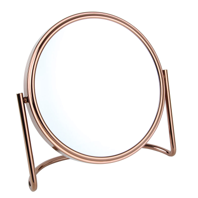 Close-up angle view of a copper finish mirror