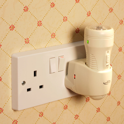 3-in1 emergency torch charging on a mains plug