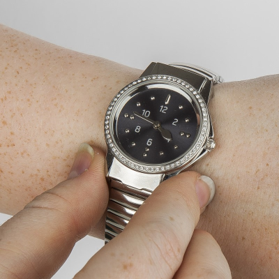 A ladies tactile watch with stainless steel expanding strap