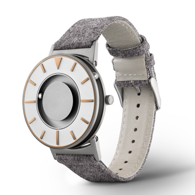 Face on stylish tactile watch with silver and gold-coloured features