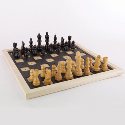 Tactile chess set with the pieces lined up to begin a game