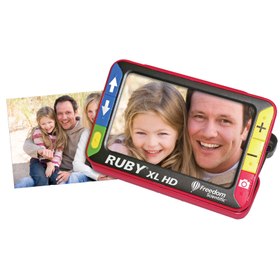 Ruby XL HD handheld video magnifier with a picture of a family photo on the screen