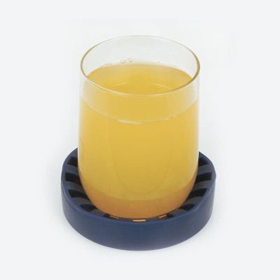 Glass of orange juice contained within the non-slip cup holder