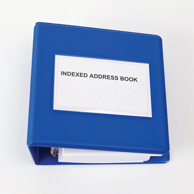 Close-up of the Braille indexed address book's cover