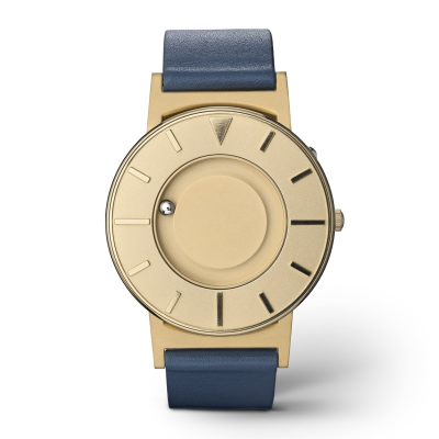 Face on of a stylish tactile watch with gold-coloured features and a navy blue leather strap