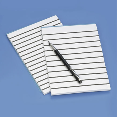 Close-up of lined paper with lines 1cm apart and a pen