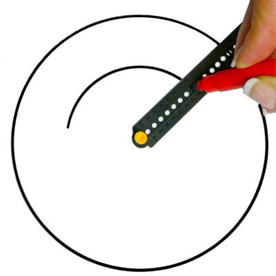 Circlemate compass in use, with a large circle already drawn and a person drawing a smaller circle