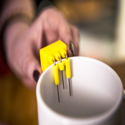 Close-up of a yellow Liquid level indicator on side of a mug