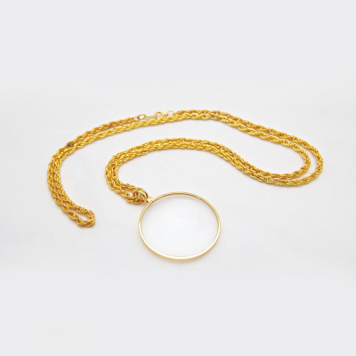 Standalone of the pendant magnifier on a gold chain