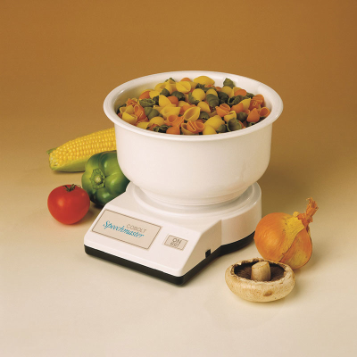 Kitchen scale with dried pasta in the bowl and other food items surrounding the scale