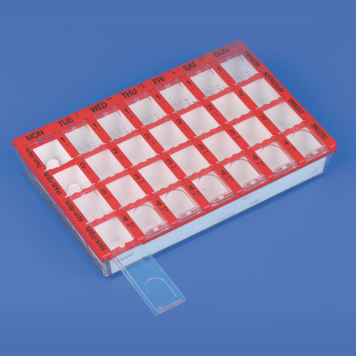 Pill organiser on a surface