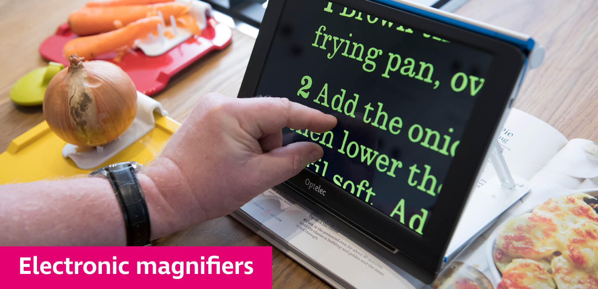 Portable magnifier being used to read a recipe book