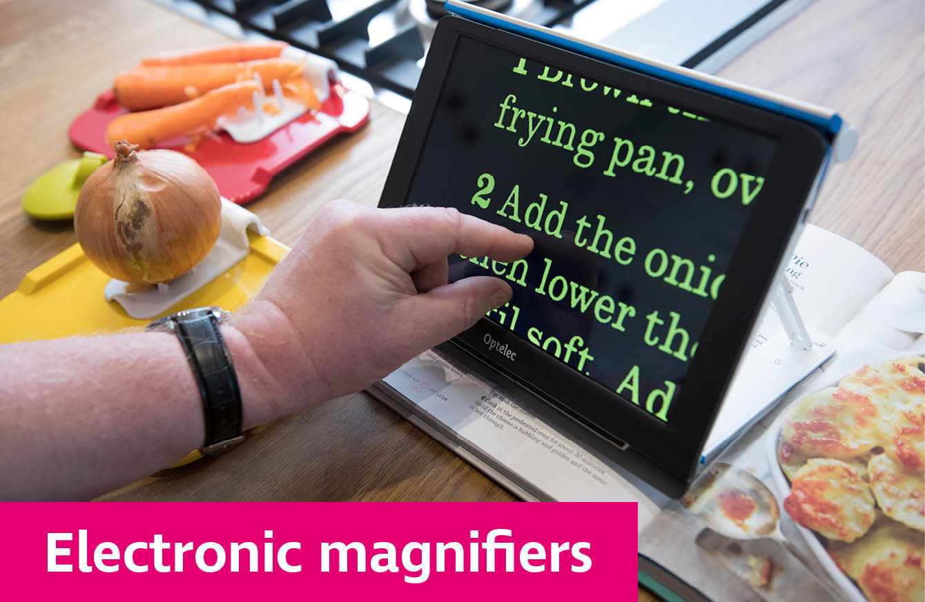 Electronic magnifier used to read a recipe book on kitchen worktop