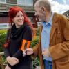 Man and woman using the Ramble Tag V2 black