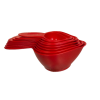Red measuring spoons nested inside each other for easy storage