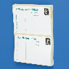 Angled stack of white self-adhesive postage labels