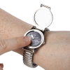 A woman wearing the watch and using the tactile markings