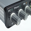 Close up image of the controls on the front of the Duo-Comm 2 splitter box audio mixer