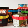 A group of tins and jars, each with one Band-It on